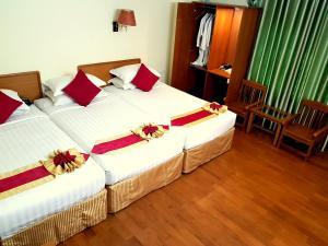 En eller flere senge i et værelse på Hotel A1