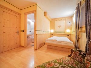 Postel nebo postele na pokoji v ubytování La Corte Appartamenti