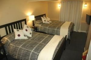 A bed or beds in a room at Douglas Guest House