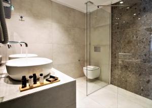 A bathroom at Odyssey Hotel