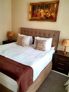 Cama ou camas em um quarto em La Casa Baku