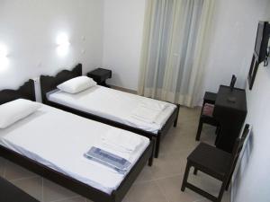 Ένα ή περισσότερα κρεβάτια σε δωμάτιο στο Argo Pension