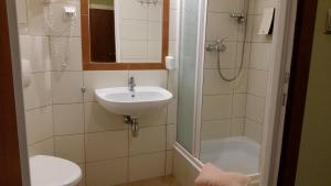 Łazienka w obiekcie Hotel Kopernik