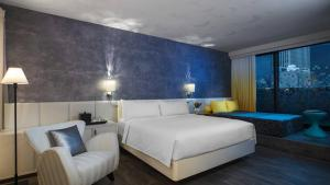 A bed or beds in a room at Renaissance New York Times Square Hotel