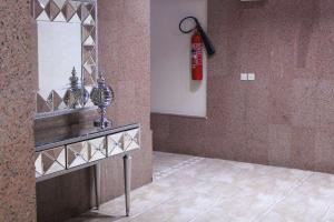 Um banheiro em Zaer Al Fakhama Hotel Apartments