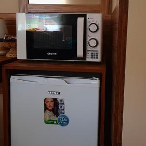 Телевизор и/или развлекательный центр в Мини-отель Дуэт