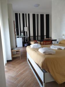 A bed or beds in a room at Cuscino e Cornetto