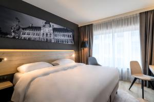 A bed or beds in a room at Park Inn by Radisson Antwerp Berchem