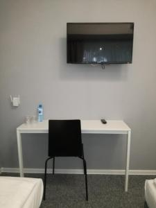 A television and/or entertainment center at City Rooms Szczecin