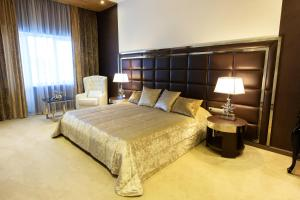 A bed or beds in a room at Vetryakov Boutique Hotel