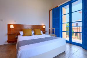 A bed or beds in a room at The Olympians Villas