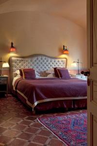 Un ou plusieurs lits dans un hébergement de l'établissement La Signoria