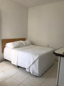 Cama ou camas em um quarto em Pousada Villa Di Loire