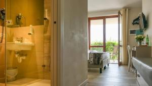 Ein Badezimmer in der Unterkunft Hotel Relais Agli Olivi