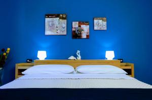 A bed or beds in a room at Zama Bed&Breakfast