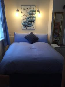 A bed or beds in a room at Marlow Lodge