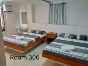 A bed or beds in a room at Eriko's House