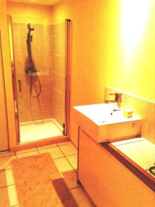 A bathroom at The Master Bedroom with private landing