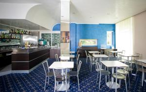 A restaurant or other place to eat at Hotel Fiera Congressi