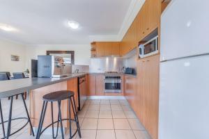 A kitchen or kitchenette at Oasis 26 - Hamilton Island