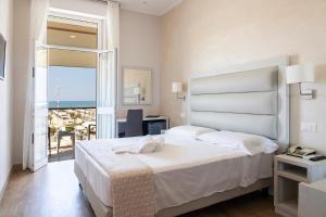 Кровать или кровати в номере Hotel Biagi