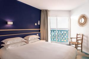 Un ou plusieurs lits dans un hébergement de l'établissement Hotel Paradou Mediterranee, BW Signature Collection by Best Western