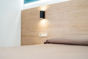 Cama o camas de una habitación en Hotel Arena Prado