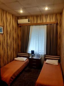 Cama ou camas em um quarto em AZPETROL HOTEL GAZAX