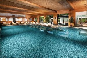 The swimming pool at or near Alm- & Wellnesshotel Alpenhof