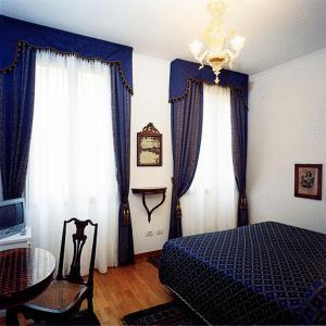 Кровать или кровати в номере Ca' Angeli