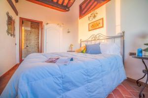 Letto o letti in una camera di Villa San Giorgio