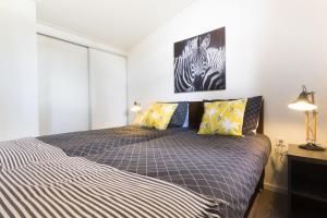A bed or beds in a room at DL Comfort 5 personen