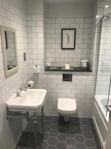 A bathroom at Redworth Hall Hotel- Part of the Cairn Collection