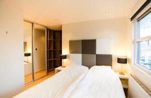 A bed or beds in a room at ND Deluxe 5 personen