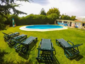 The swimming pool at or near Carcavelos Surf Hostel & Surf Camp
