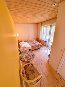 A bed or beds in a room at Mazā Kāpa