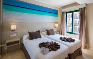 Säng eller sängar i ett rum på Benalmadena Palace Spa