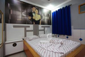 A bed or beds in a room at Motel Vison (Próximo GRU Aeroporto)