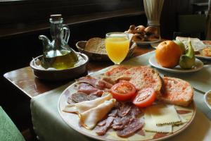 Breakfast options available to guests at Hotel Saurat