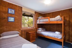 A bunk bed or bunk beds in a room at Split Point Cottages