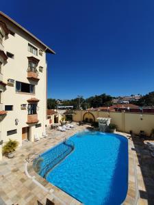 A piscina localizada em Hotel Portal das Aguas ou nos arredores