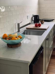 A kitchen or kitchenette at Frangipani House Cooks Hill