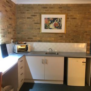 A kitchen or kitchenette at Hawks Nest Motel