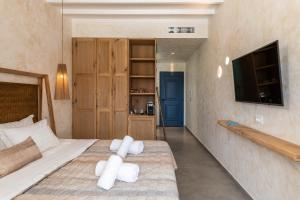 A bed or beds in a room at Panormos Village