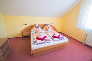 Posteľ alebo postele v izbe v ubytovaní Penzion Ajda