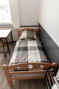 A bed or beds in a room at Monteurwohnung - Hostel - Zimmer - Hotel easy