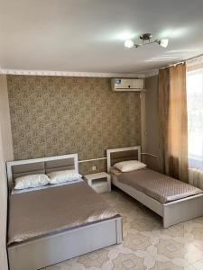 Кровать или кровати в номере Мини-отель Алгор