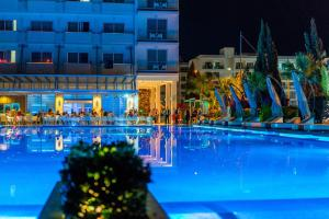 The swimming pool at or near Nestor Hotel
