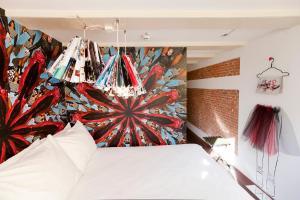 Ein Bett oder Betten in einem Zimmer der Unterkunft Hotel The Exchange