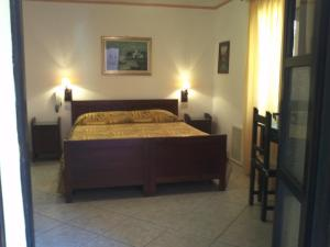 A bed or beds in a room at Hotel Abbaruja